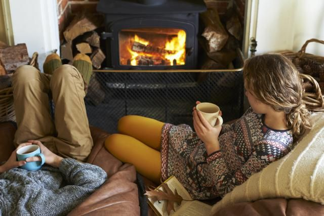 Stay warm and keep your electric bill down. These tricks will keep you cozy without turning up the thermostat.