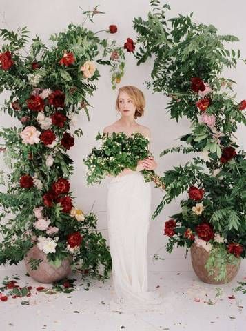 red wedding ideas green and red floral wedding alter