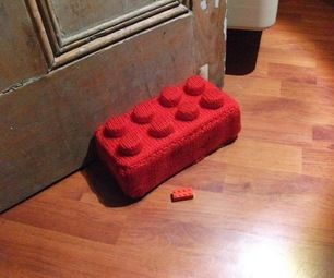 I was racking my brains for an idea for the build with yarn contest when I came up with this: How to make a giant Lego brick doorstop using yarn, a br...