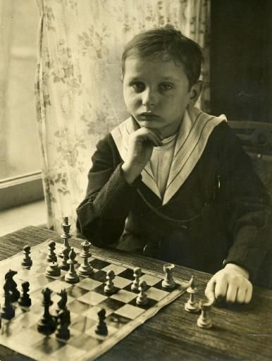 Sammy Reshevsky, child prodigy. What is interesting about this photo is that the horse's head is missing from the knight on f3.