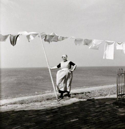 Urk, photo by G.A. van der Chijs, 1958.  .  .  .  .  Breezy, and that counts for a lot! Dutch woman who traditionally has everything scrubbed clean and shiny.