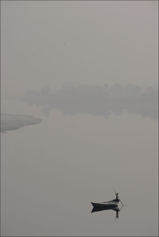 Yamuna River by Igor Logvin.   I find this photo rather interesting.  Very lonely and desolate.
