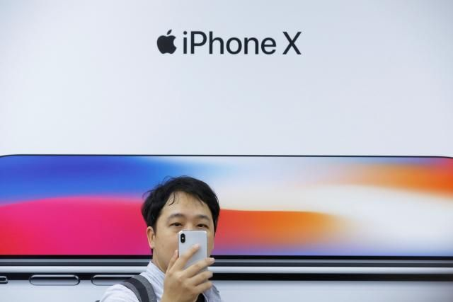 Shares in several of Apple Inc's Asian suppliers fell for a second straight day on Tuesday, hurt by a report from Taiwan's Economic Daily and some analysts saying that iPhone X demand could come in below expectations in the first quarter.