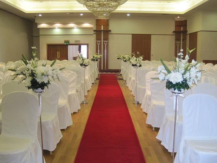 ceremony decoration by all about weddings with silver stands and tall floral displays