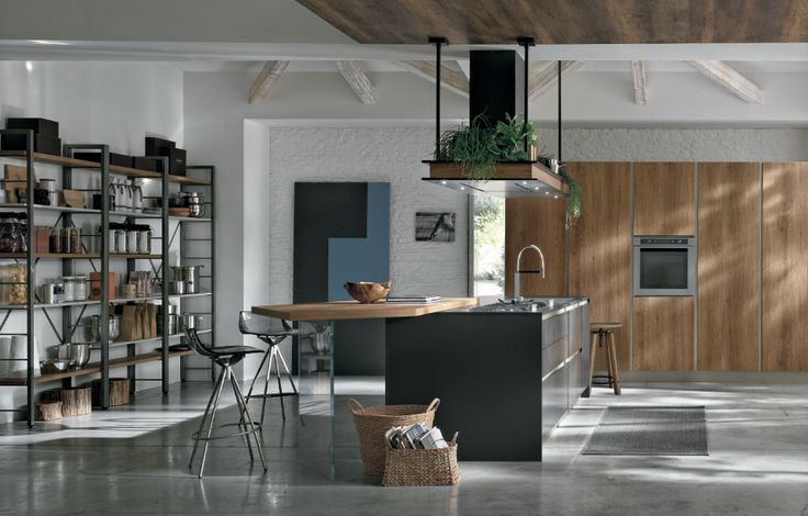 When country meats contemporary. A soft Fenix NTM Nero Ingo (0720) matt design by Stosa Cucine.