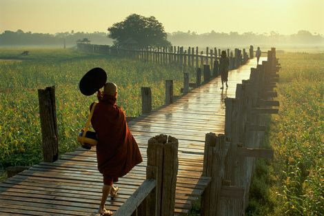 U Bein Bridge and Buddhist monk in Burma by Frans Lemmens / Stone / Getty