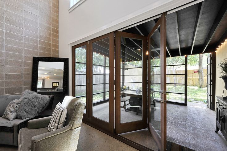 accordion doors Patio Transitional with accent wall cinder block wall folding doors