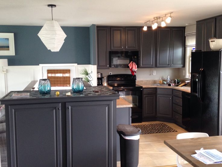 My kitchen blue slate walls and peppercorn cabinets by for Charcoal painted kitchen cabinets