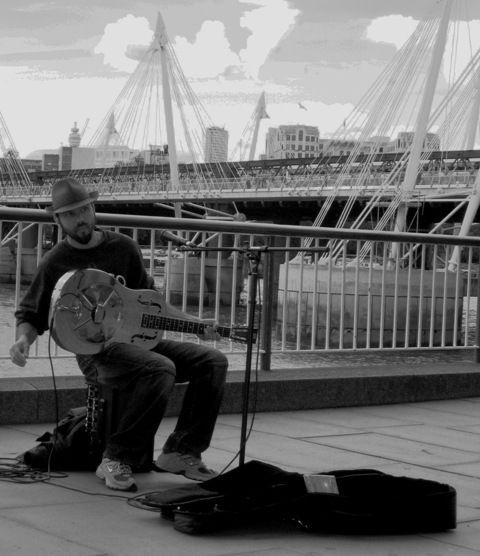 Busker on the Southbank, London.