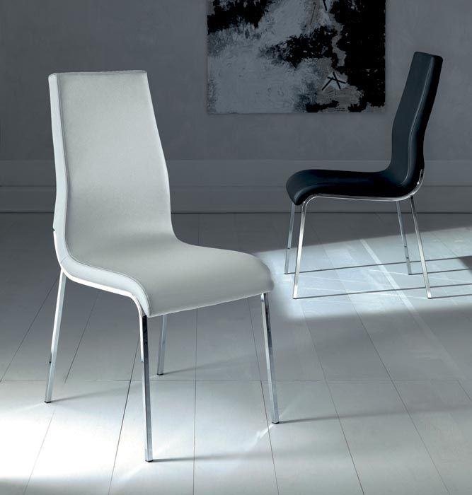 MILA. The back of the chair is high, enfolding and it supports the human back in a natural and ergonomic way.  Metal frame chair, soft eco-leather covered shell, leather colour stitching. http://www.easy-line.it