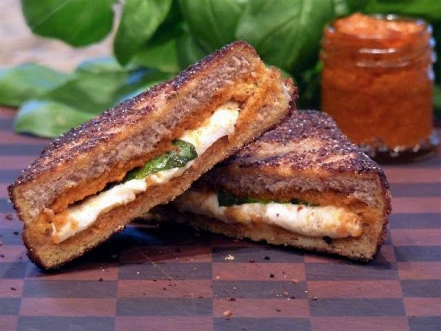 Mozzarella en Carozza, Valastro Style - ButterYum  Have you checked out Buddy Valastro's new cooking show, Kitchen Boss? It's  great. He cooks all my favorite foods just the way my mother did when I  was growing up. She didn't, however, make these Italian Grilled Cheese  sandwiches. My girls are lucky I'm not my mother ;).  They've both  proclaimed these to be the best sandwiches ever. Oh yeah, baby - they're  that good!  Let's make one - first, we schmear some sun-dried tomato pesto…