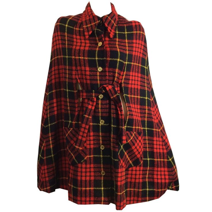 """1960s brilliant red plaid cape with waist sash, gold tone metal buttons. Side pockets, peaked collar. Lined in bright yellow acetate rayon. no flaws. Measures 17"""" shoulders, 34"""" long ,68"""" around hem"""