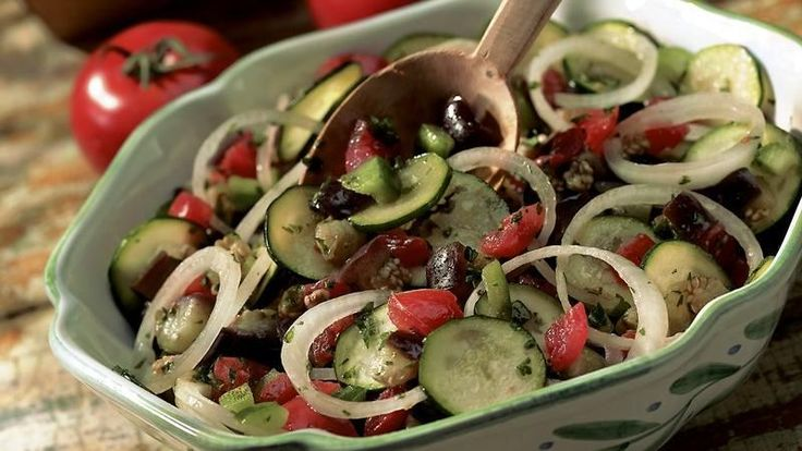 Traditional ratatouille ingredients—eggplant, tomatoes, zucchini, onion, bell peppers and fresh herbs—are even better when tossed as a salad!