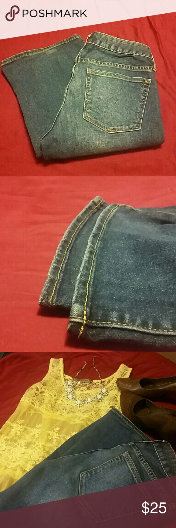 Cute GAP boot cut jeans Nice medium-dark blue.  Goes great with something sparkly or dressed down with a white tee for a more casual look.  Mid-rise with plenty of curve-hugging stretch to accentuate your assets ;) GAP Jeans Boot Cut