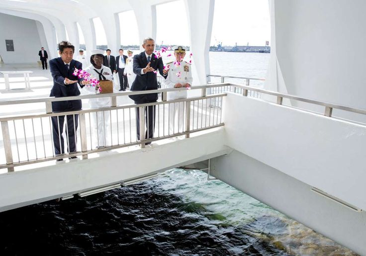 """""""President Obama and Prime Minister Shinzo Abe of Japan toss flowers at the wishing well after layin... - Official White House Photo by Pete Souza"""
