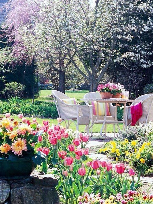 Photo credit- bloglovin.com A very pretty garden setting only needs simple cane chairs and an iron table with cushions.