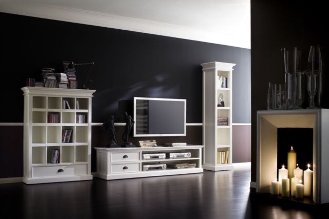 The low profile of this Large entertainment center offers the perfect platform for showcasing all your media components. Television viewing is at the perfect height and shelving provides ample allowance for additional electronic devices. Cord cutouts are in place for ease of connectability. Drawers can house smaller accessories and instruction manuals. The solid wood construction with detailed molding, is highlighted with a semigloss painted finish. Flared crown molding and detailed trim add…