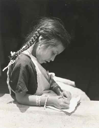 Untitled (Girl with Braids Writing), ca. 1926-29 photographed by Tina Modotti