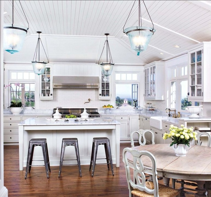 Great Transitional White Kitchen: White Carrera Marble Countertops Atop White  Cabinetry Give This Kitchen A Fresh And Classic Look.