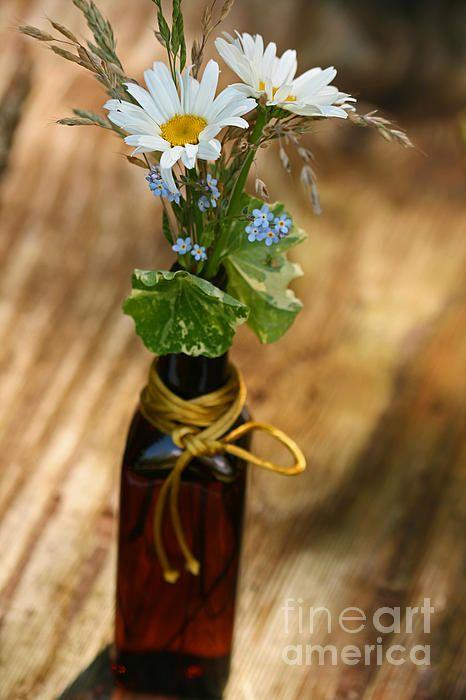 flowers in a brown bottle.