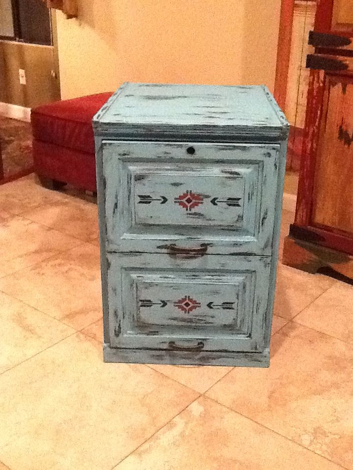 Dad's  file cabinet refinish. I took it from boring oak to distressed southwestern finish.