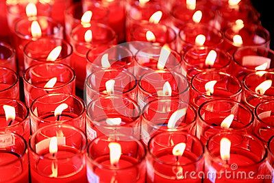 Pray with red candlelights