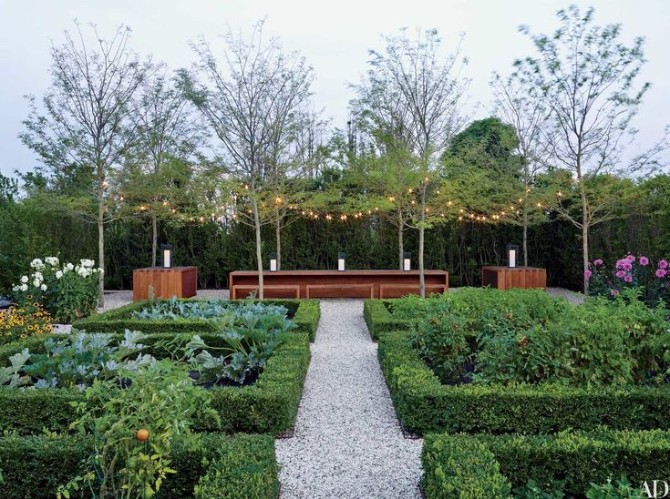 """A working garden also makes a lovely setting for a party. """"When creating a vegetable and cutting garden, we love to include an outdoor dining space,"""" says Sawyer. """"At this Hamptons home, the enormous teak picnic table is perfect for a joyous summer meal featuring bounty from the garden."""""""