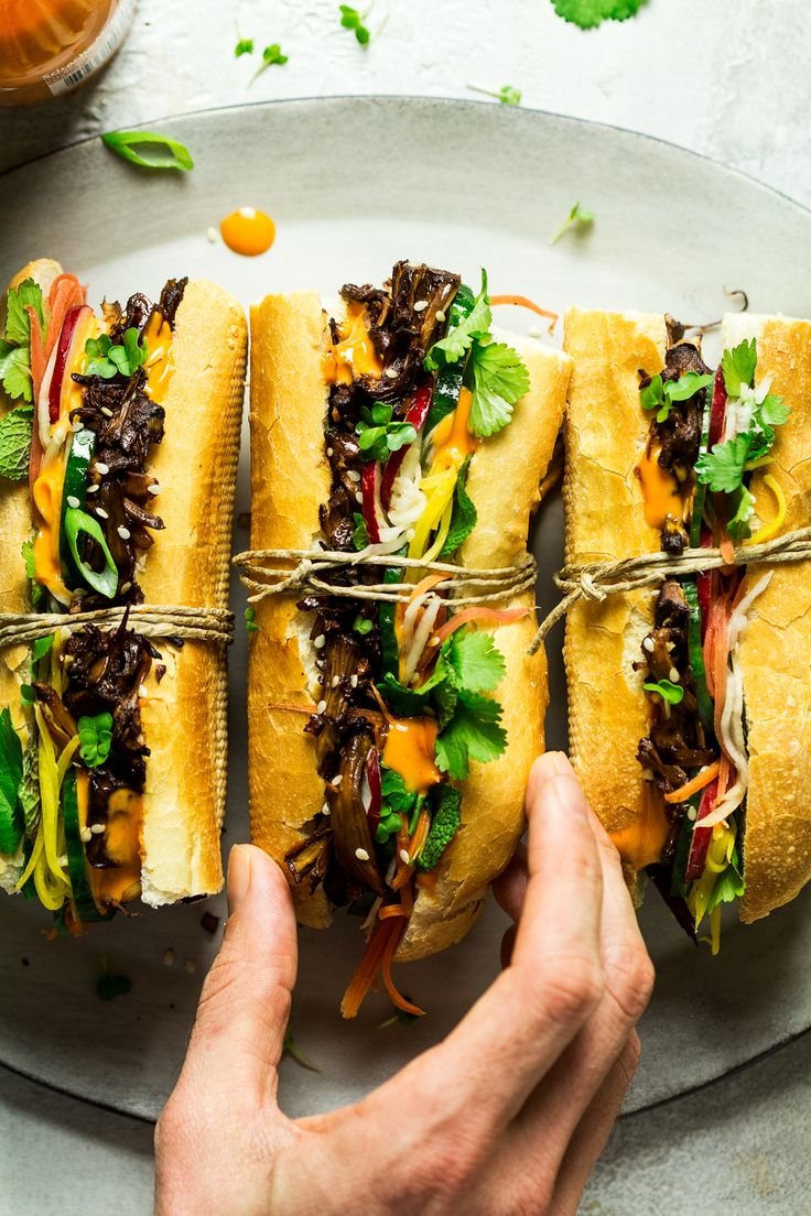 Vegan pulled pork banh mi is a meat-free take on this world-famous Vietnamese sandwich. Young jackfruit marinated in minced lemongrass, ginger and garlic and then baked makes for a delicious filling along with fresh veggies, pickles, coriander and Sriracha mayo.