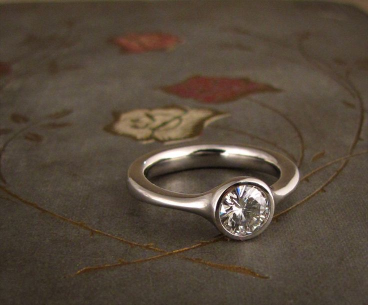 Low-Profile Solitaire Engagement Ring - Made to Order by ginandbutterflies on Etsy https://www.etsy.com/listing/101751231/low-profile-solitaire-engagement-ring