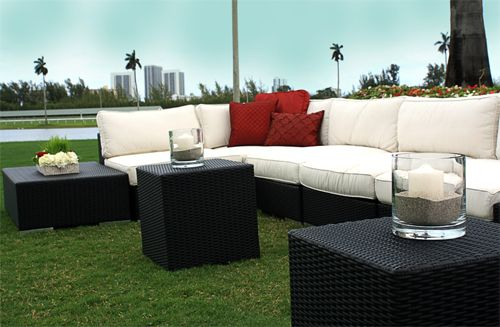This Black Woven Lounge Set looks elegant with the red accent pillows. Could you imagine this piece at your next event?