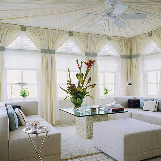 Light and white: We love the drapery on the ceiling!