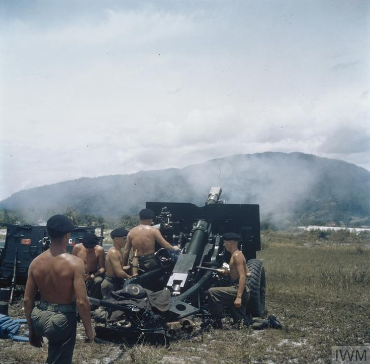 Royal Artillery 25-pounder gun crew in action against insurgents entrenched in the hills east of Kampar Perak State Malaya November 1957. [OS] [800x788]