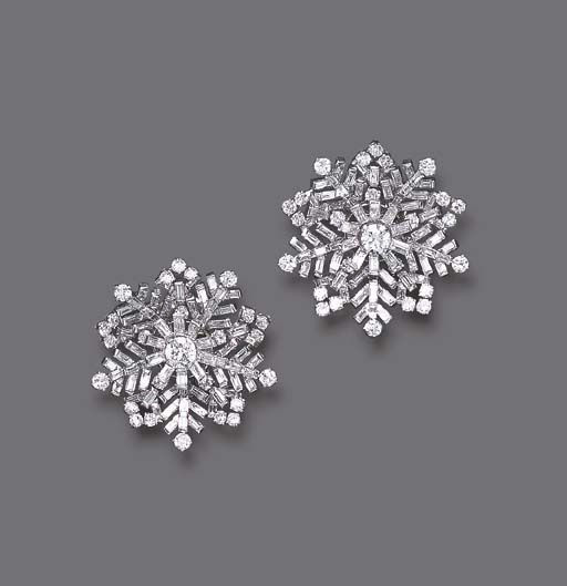 "A PAIR OF DIAMOND ""SNOWFLAKE"" EAR CLIPS, BY VAN CLEEF & ARPELS Each circular and baguette-cut diamond snowflake of openwork design, mounted in platinum, circa 1946"