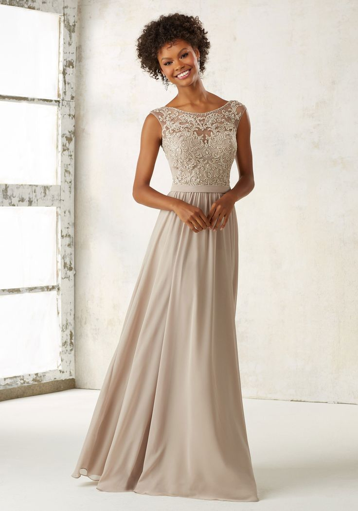 Ornate Embroidery and Beading Accentents the Illusion Bodice on This Elegeant Chiffon Bridesmaids Dress. Open V Back with Zipper Closure. Shown in Latte. Available in All Embroidered Chiffon Color Opt