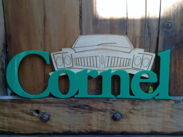 Laser Cut Name in Wood with wood Cut detail and the name in Perspex