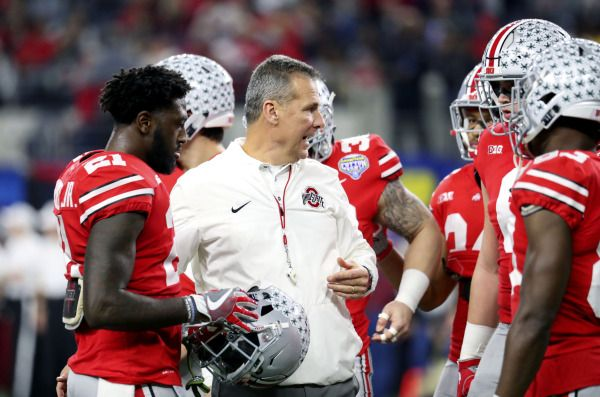 Dec 29, 2017; Arlington, TX, USA; Ohio State Buckeyes head coach Urban Meyer speaks to players before the game against the USC Trojans in the 2017 Cotton Bowl at AT&T Stadium. Mandatory Credit: Kevin Jairaj-USA TODAY Sports