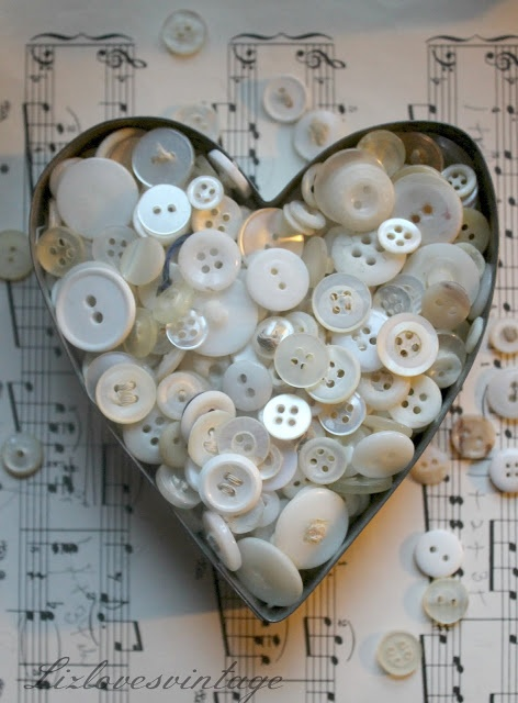 Vintage buttons in an old cookie cutter ♡