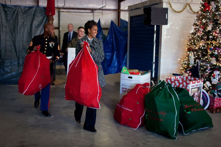 First Lady Michelle Obama delivers toys donated by White House staff to the Marine Corps Base Quantico Toys for Tots Campaign warehouse in Stafford, Va., Dec. 16, 2009. (Official White House Photo by Chuck Kennedy)