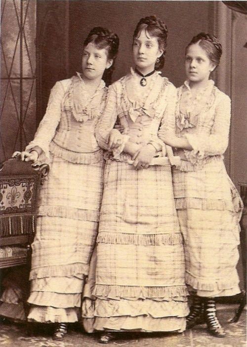 Spanish infantas: Maria Paz (later Pss in Bavaria), Maria del Pilar (died in 1879) and Eulalia (later Duchess of Galliera). The three were daughters of Queen Isabel II of Spain.