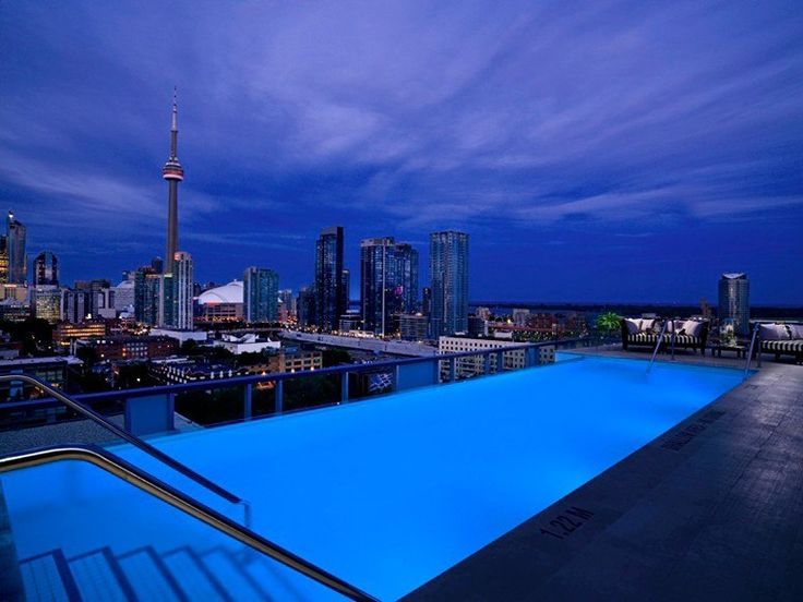 THE ROOFTOP INFINITY POOL AT THE THOMPSON Toronto, Ontario What You'll See: Situated on the roof of the swanky hotel, guests can gaze at 360 views of Toronto's skyline and Lake Ontario. The pool itself is built on a raised platform, so guests are at eye level with the water the second they step out of the elevator.
