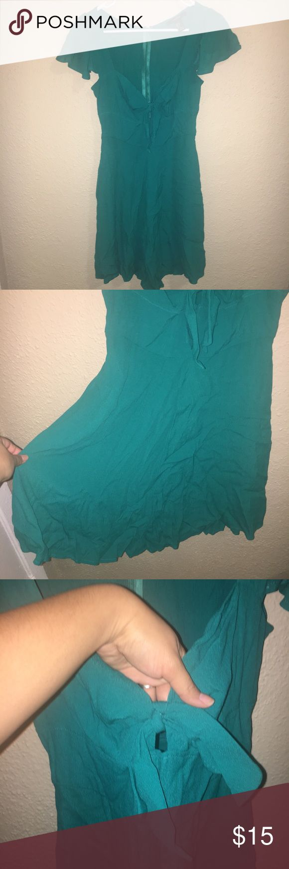 Turquoise Key Hole Tie Dress with Sleeves New, but never worn. It didn't fit me and was stored away when I moved. It's in amazing condition, no tears or stains. The picture above illustrates how the front of the dress fits on. A line skirt that begins at the waist, which really accentuates a thin long figure! Forever 21 Dresses Mini