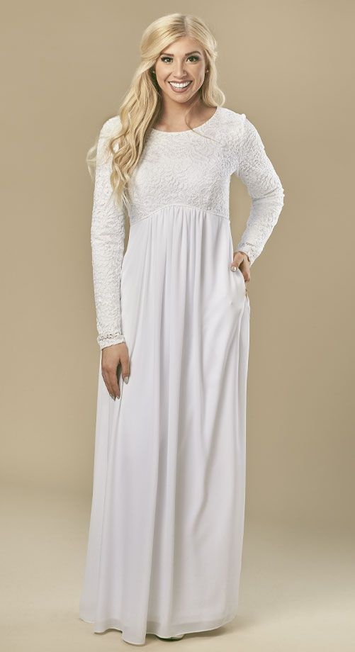 Soft, luxurious raised lace places this dress in the simply glorious category.  All lace bodice front and back with sweeping skirt of soft doby fabric,  fully lined with opaque denier makes this one of the most comfortable and flattering LDS Temple dresses.  Careful styling, sizing and the perfect details such as the piping at the empire waist, is the long awaited dress White Elegance customers have been looking forward to ordering.  Sizes:  XXS-2, XS-4/6, S-8/10, M-12/14, L-16...
