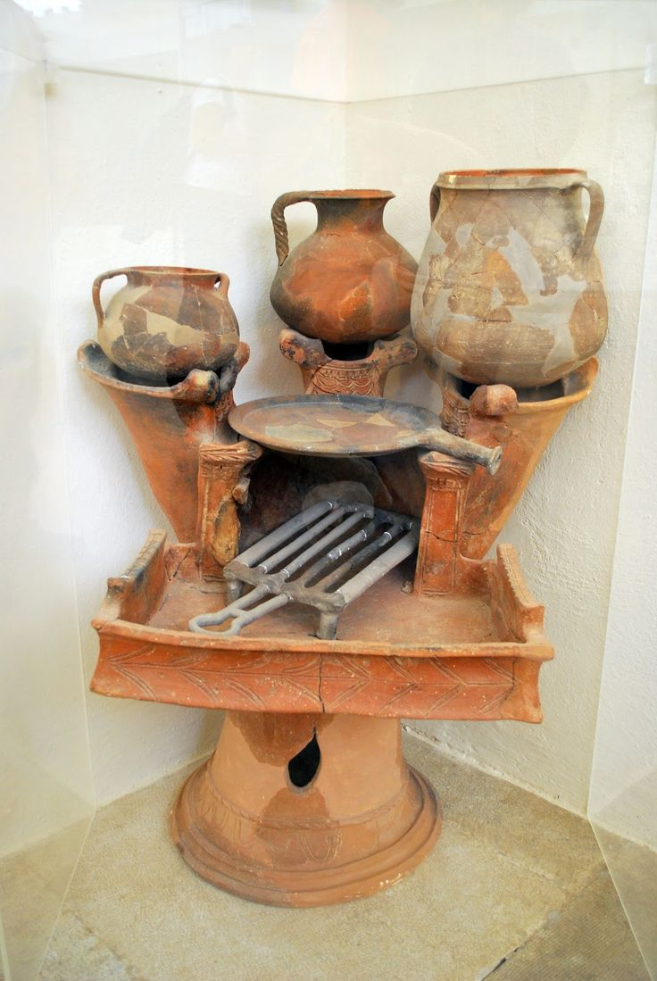 Ancient Greek Kitchen Oven and earthenware cooking utensils Archaelogical museum of Delos