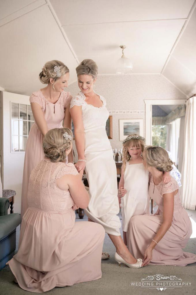 The bride getting ready with her bridesmaids and flowergirl. Check out other wedding photography by Anthony Turnham at www.snapweddingphotography.co.nz