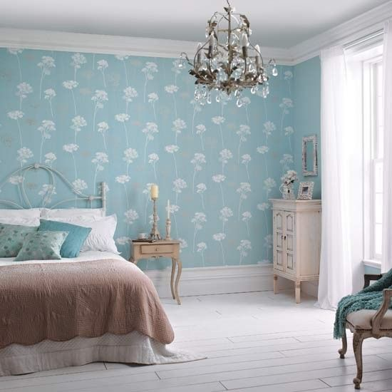 Dulux's 'Meadowsweet' teal wallpaper is the highlight in this slightly shabby chic bedroom.