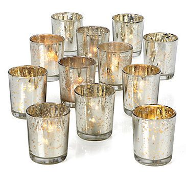 Fill your home with a warm holiday glow with mercury glass Votive Cups. Set of 12, $19.95