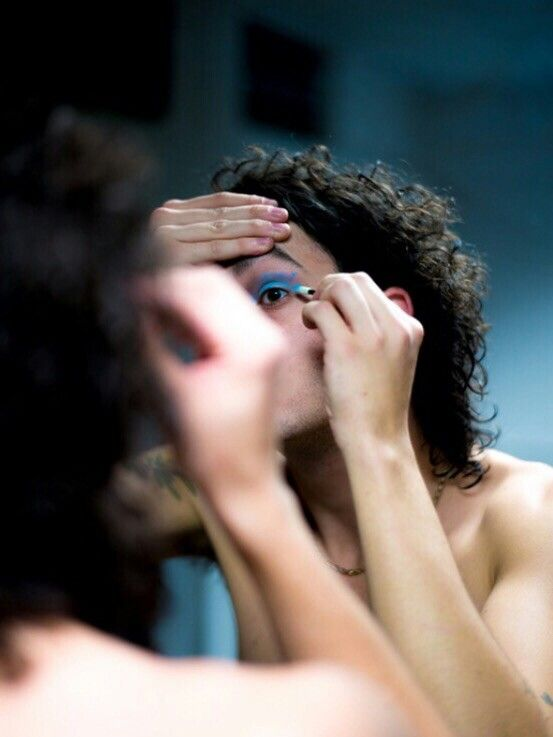 Matty Healy from the 1975 experimenting with makeup backstage.