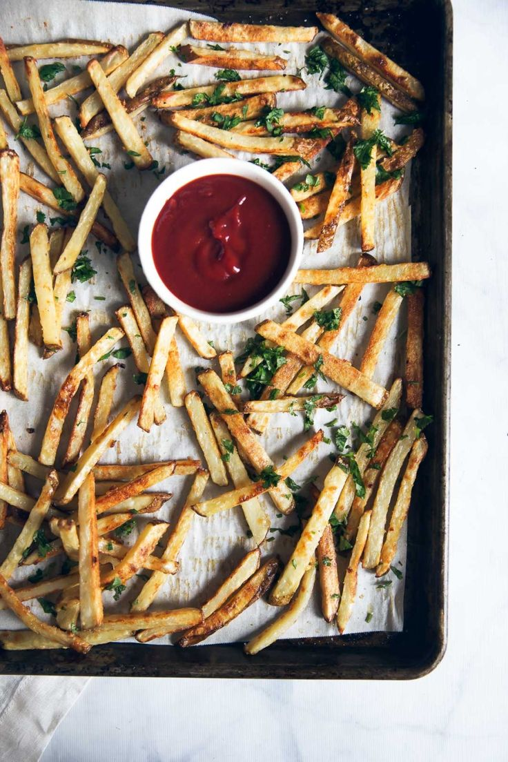 Crispy, homemade healthy baked french fries! Flavored with a little truffle oil, parmesan and garlic. A restaurant favorite you can make right at home. #healthysnack #frenchfries #appetizer