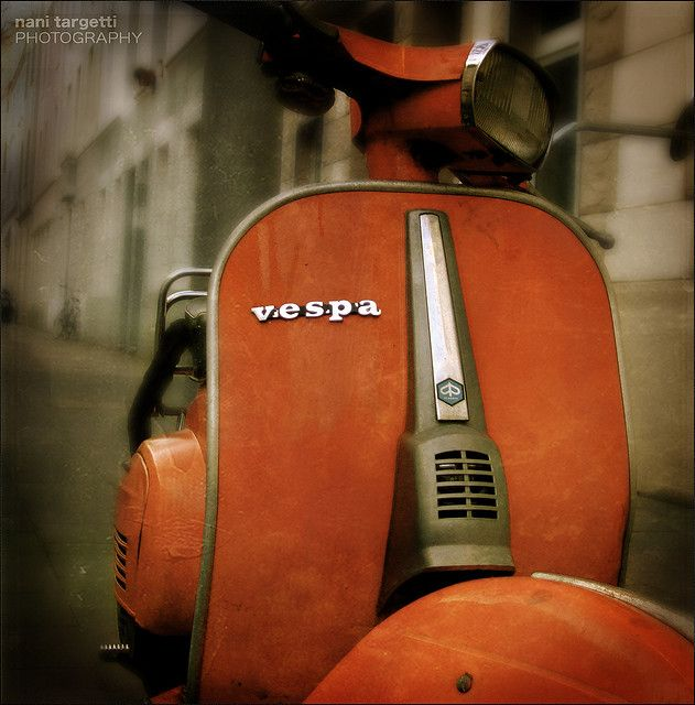 Vespa. I would sooo get me one of these if I lived at the beach or in a small village.