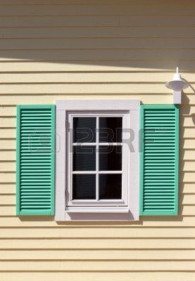 Window with green shutters on yellow wall Stock Photo - 3767237